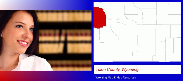 a young, female attorney in a law library; Teton County, Wyoming highlighted in red on a map