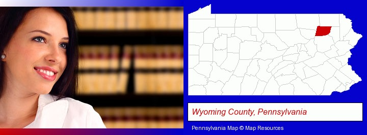 a young, female attorney in a law library; Wyoming County, Pennsylvania highlighted in red on a map